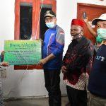 Plt Gubernur Aceh Serahkan Rumah Bantuan untuk Warga Asan Nicah
